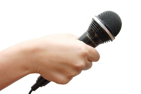 5072263 - woman hand holding a microphone on white background